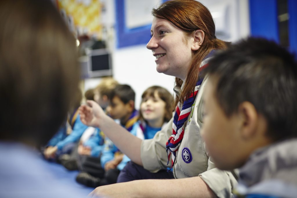 A female leader with scouts.